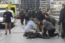 Injured people are assisted after an incident on Westminster Bridge in London